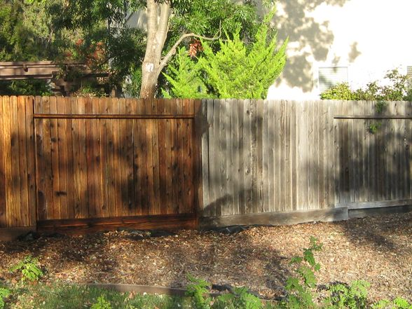 wood fence before and after power wash and stain seal